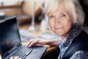 elderly woman at laptop