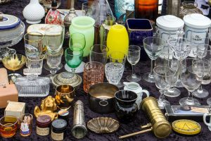 old glass collection on flea market table