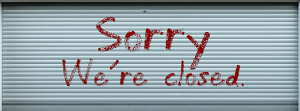 closed sign on store front