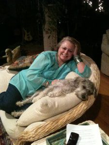 relaxed dog on chair with woman