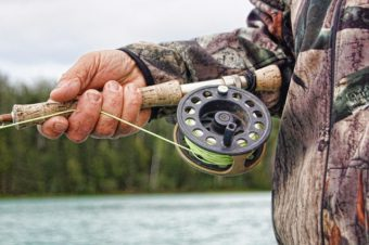 hand and fishing reel