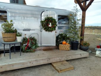 air stream trailer boutique with Christmas wreath